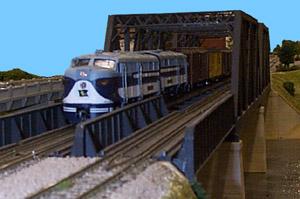 Dan McClary's Ann Arbor FA-2s bring a time freight  across the bridges on Skip McDonald's river module.