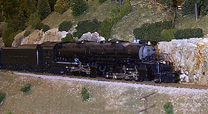 The EM-1 drags a long string of hoppers up the grade<br>  on Skip McDonald's horseshoe-shaped module.