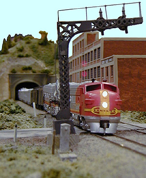 Doug Fleshman's Santa Fe <i>Scout</i> speeds past the cannery at Madison.