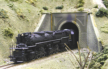 <p>A C&amp;O Allegheny bursts out of one of the three tunnels<br>on Skip McDonald's horseshoe-shaped module. </p>