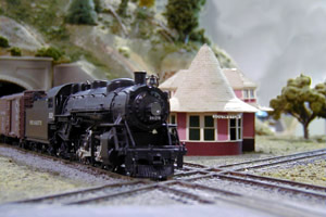 An eastbound Pere Marquette freight thunders past<br>  Dan Gawrych's scratchbuilt South Lyon depot.