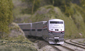 Jeff York's Amtrak Superliner rounds Duane Heard's mountain.