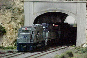 Modern railroading is not neglected on our layout as a trio<br>