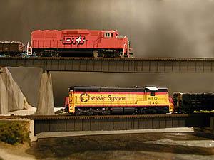 A very overcast sky makes the vivid colors of the motive power<br>