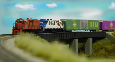 Brian Everett's DT&I Geeps cross a highway on his corner module