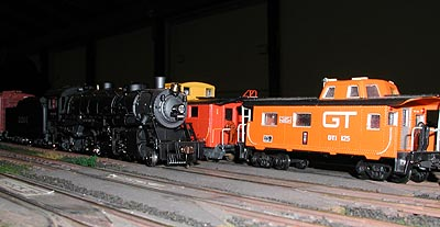 Old meets new as a Wabash Mikado meets a modern DT&I caboose in Butler Yard.