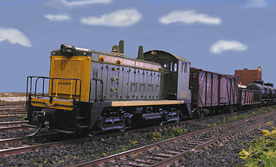 A short GTW local freight waits in the yard for clearance to enter the mainline.