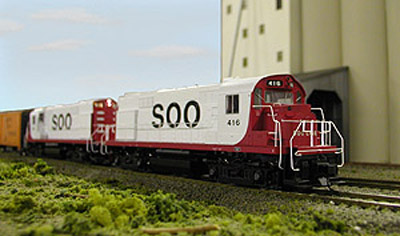 Dave Bowman's Soo Line DL640s pass the grain elevator at Hale early in their careers.