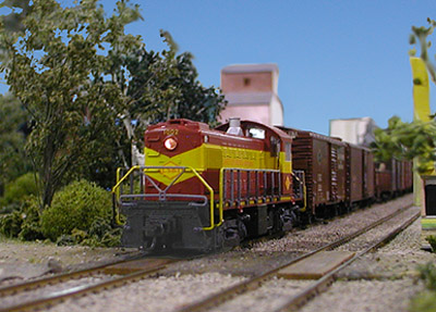 Al Robertson's LS&I RS-1 leads a freight out of Branchton.<br>