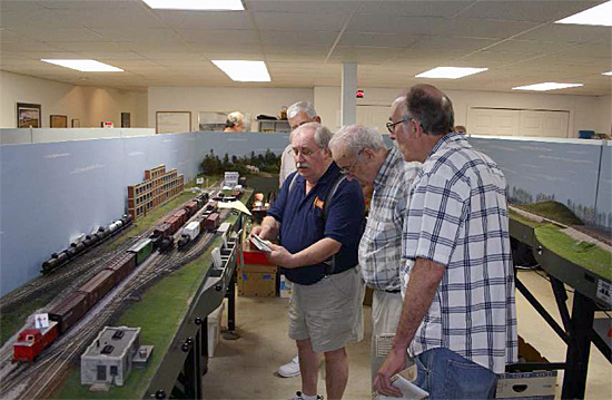 The NCR NMRA board of Directors enjoys a session on the Operations Road Show layout