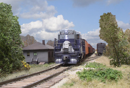 Extra 450 West, departing Burrows.<br/><i>Photo by Craig Wilson</i>