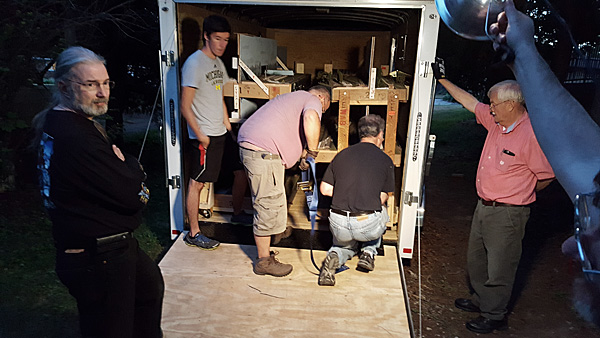 Paul, Jordan, Brian, David Pickell and Walt loading one of the four trailers for the trip to Indy.
