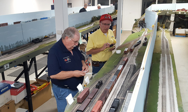 John Young and a guest set out cars at Logansport at the operating session we<br/>held for Great Lakes Express 2016, the 2016 North Central Region NMRA Convention.